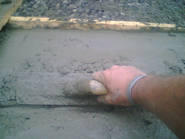 Rob Sharkey working with concrete wearing one of John's support wristbands!