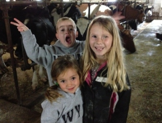 John, Clara and Kayla in the barn