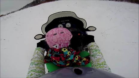 Clara snowmobiling with Abby