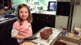 Clara helping to make my pirate's treasure cake