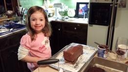 Clara helping to make my pirate's treasure cake
